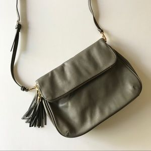 Gray crossbody bag with tassel zipper pulls